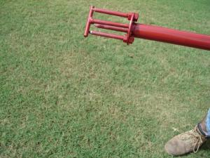 Push down spring loaded ejection rod on the Turf-Tec WeedAway to remove weed from tool