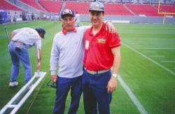 Superbowl XXXV, Tampa Stadium in Tampa, FL.  George Toma, agronomist for the NFL with John Mascaro on field.